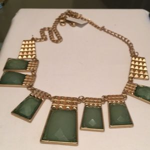 Gold tone choker with green stones